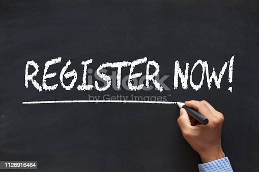 Register Now handwriting with chalk marker on blackboard. Business Concept.