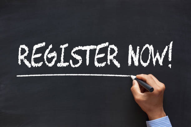 Register Now Concept Register Now handwriting with chalk marker on blackboard. Business Concept. register stock pictures, royalty-free photos & images