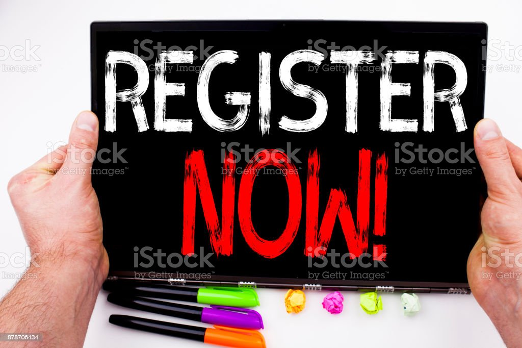 Register Now text written on tablet, computer in the office with marker, pen, stationery. Business concept for Internet Registration Subscribe white background with copy space stock photo