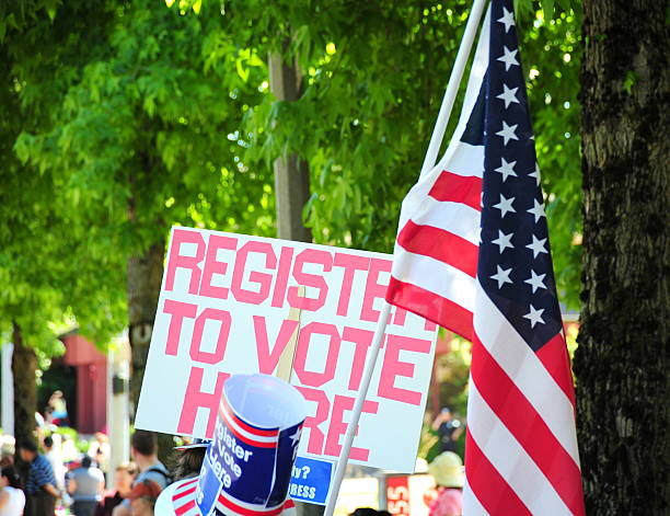 register to vote - vote sign stock photos and pictures