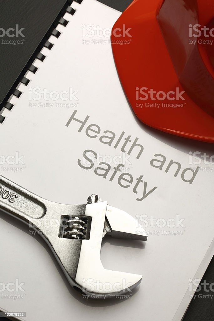 Register with helmet and spanner royalty-free stock photo