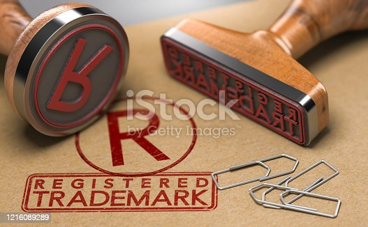 3D illustration of two rubber stamps with the text registered trademark and the symbol R over brown paper background. Trade-mark Registration Concept