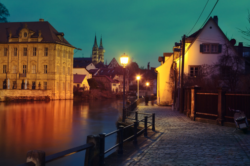 Regnitz quay, Schloss Concordia and Imperial cathedral in evening Bamberg.