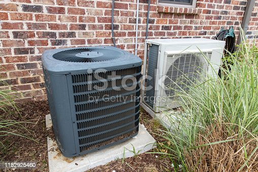 istock Regular home HVAC air conditioner system and mini-split next to each other. 1152925460
