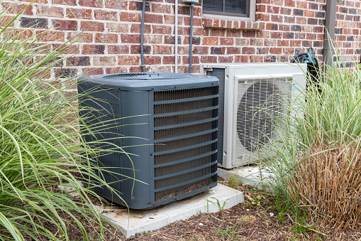 istock Regular home HVAC air conditioner system and mini-split next to each other. 1152925482