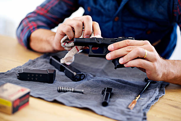 Regular maintenance is essential for every gun owner stock photo