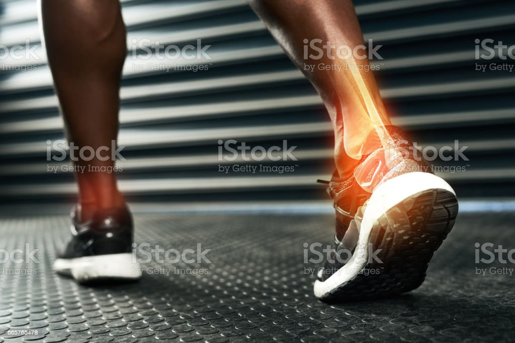 Rehabilitating his ankle after injury stock photo
