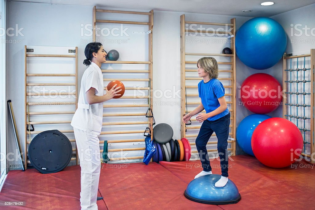 Rehabilitation exercises with ball stock photo