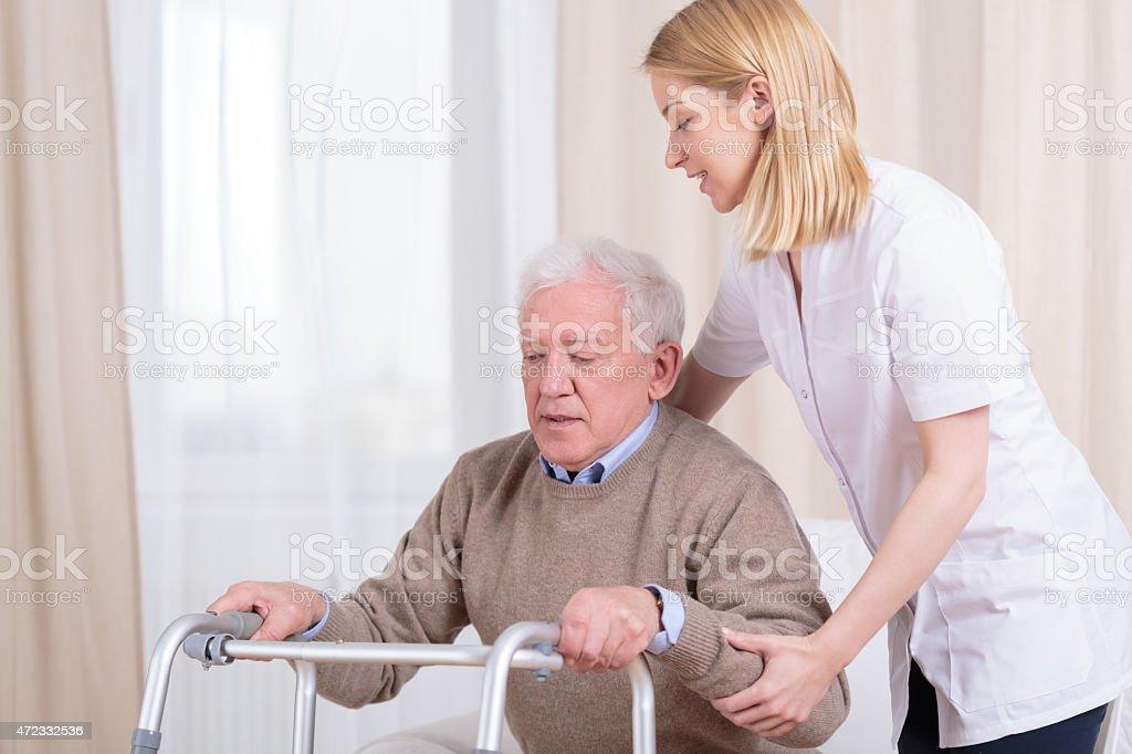 Rehabilitation in nursing home stock photo