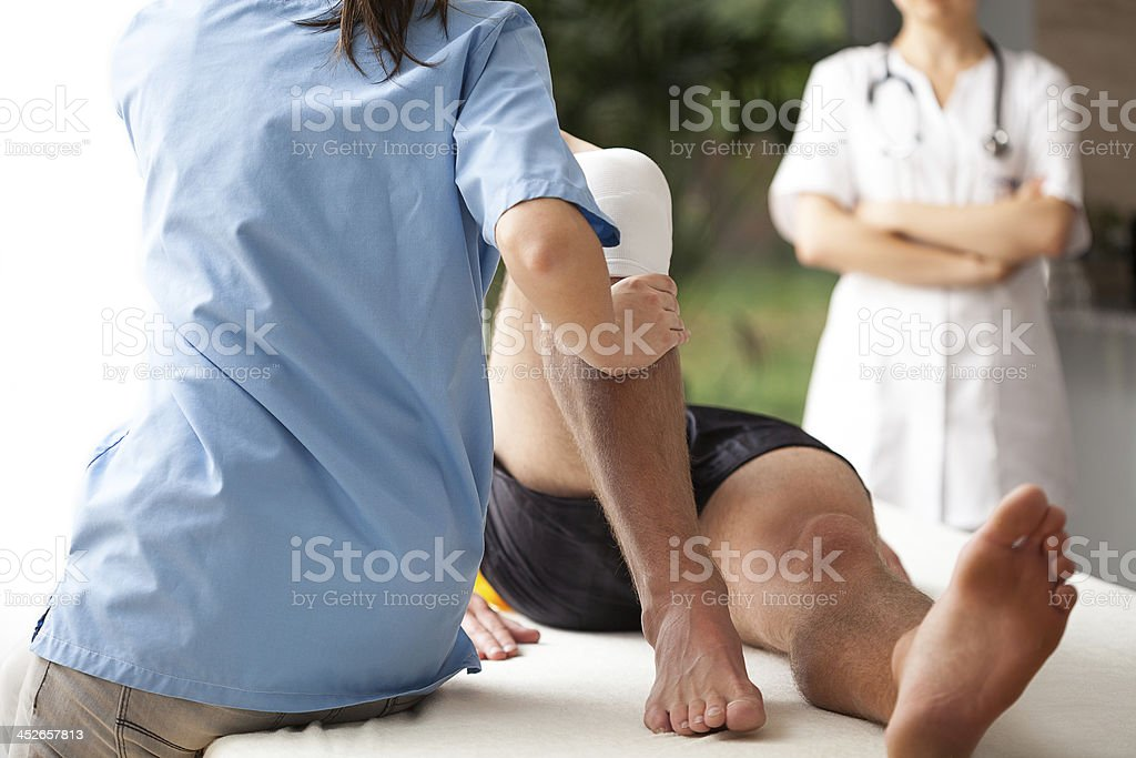 Rehabilitation of broken leg stock photo