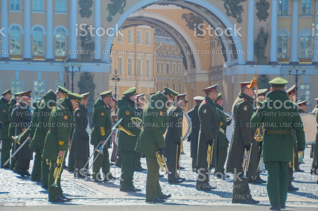 rehearsal of the military brass band on the background of the headquarters ' arch stock photo