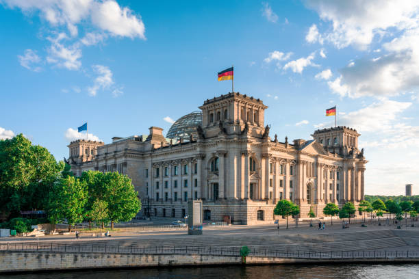 Reichstag and government district in Berlin, Germany Reichstag with german flag, Berlin, Germany berlin stock pictures, royalty-free photos & images