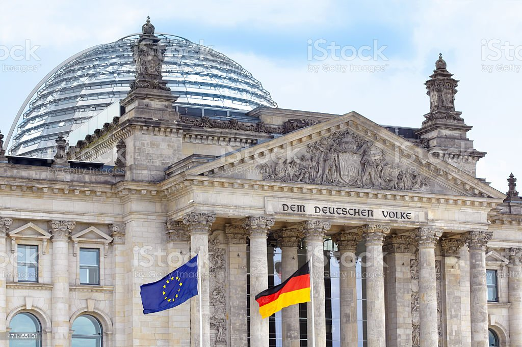 Reichstag, Berlin wih German and European flags stock photo