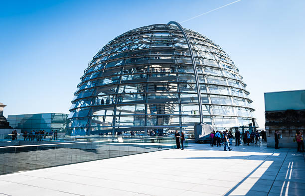 Reichstag glass dome Berlin, Germany - March 23, 2012: Reichstag glass dome construction above German parliament (Bundestag). Construction of cupola (designed by architect Norman Foster) was finished in 1999, the seat of Bundestag was transfered here also same year. People visiting the monument on the rooftop. cupola stock pictures, royalty-free photos & images