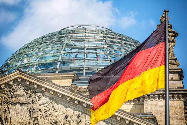 Reichstag in Berlin with German Flag Reichstag in Berlin with German Flag cupola stock pictures, royalty-free photos & images