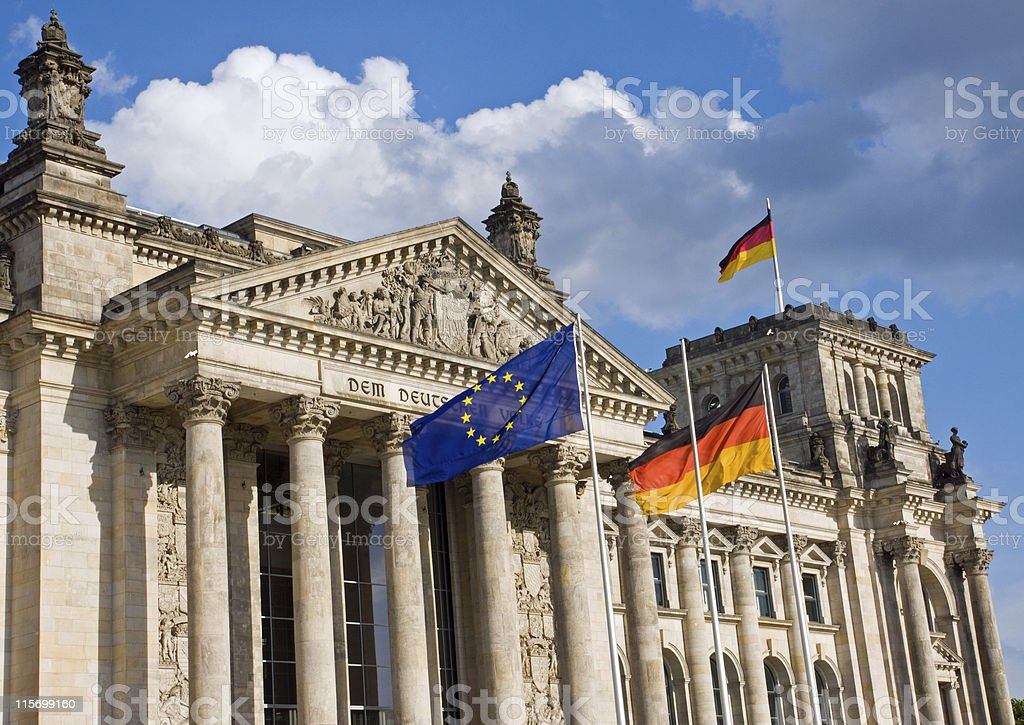 Reichstag with German and European flag stock photo