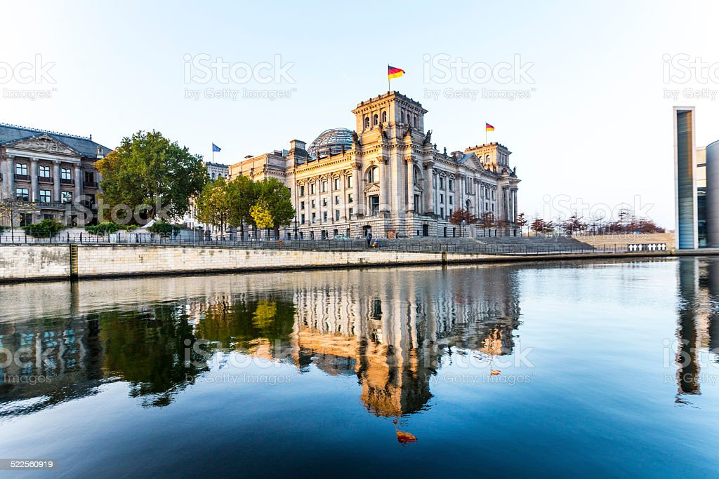 reichstag (bundestag) with reflection in spree river in berlin stock photo