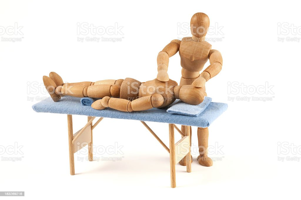 Reiki - wooden mannequin gets a therapie with healing hands royalty-free stock photo
