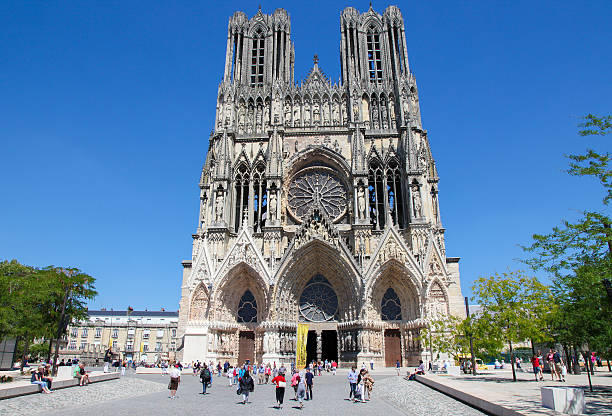 Reims cathedral Reims, France - July 3, 2011: Unidentified people near Reims Cathedral in Champagne region, France. marne stock pictures, royalty-free photos & images