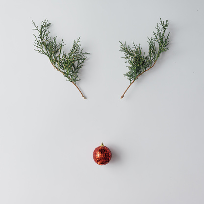 istock Reindeer face made of Christmas decoration and pine branches. Mi 623773614