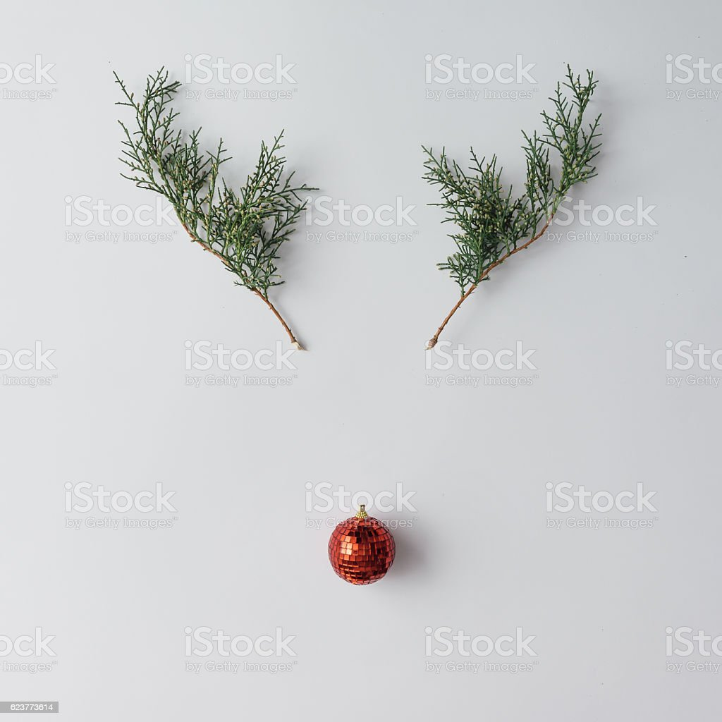 Reindeer face made of Christmas decoration and pine branches. Mi stock photo