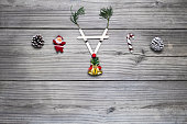 istock Reindeer face made of Christmas decoration on vintage wood table. 1046386910