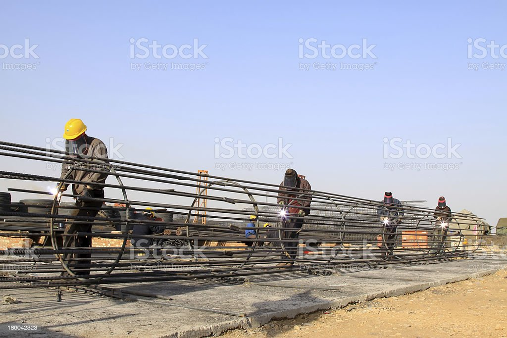 reinforced component at the construction site and workers stock photo