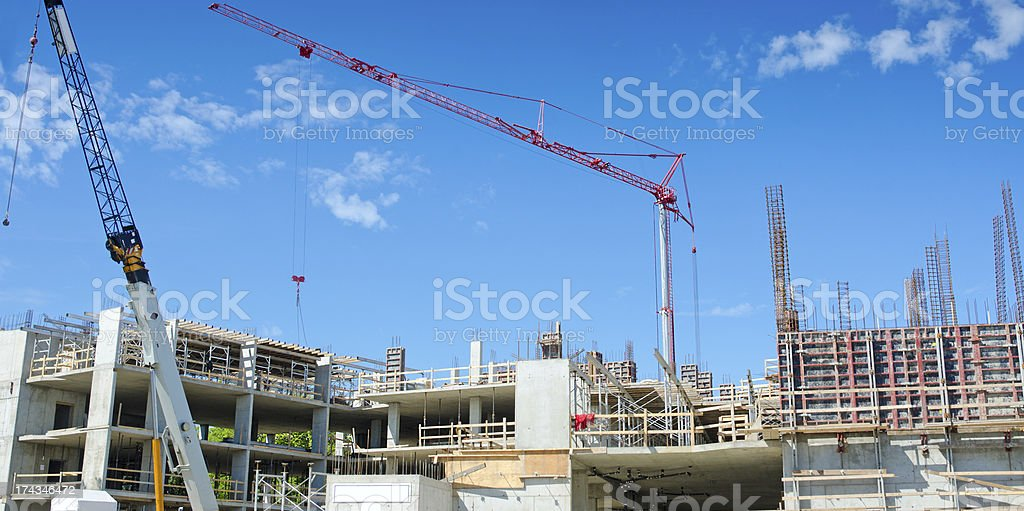 Reinforced Concrete Construction Site with Tower and Mobile Crane royalty-free stock photo