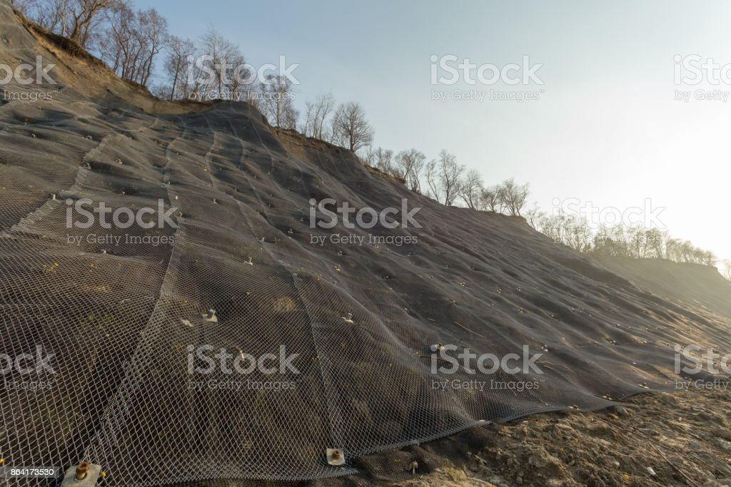 reinforcement of the shore with a metal mesh, reinforced reinforcement royalty-free stock photo