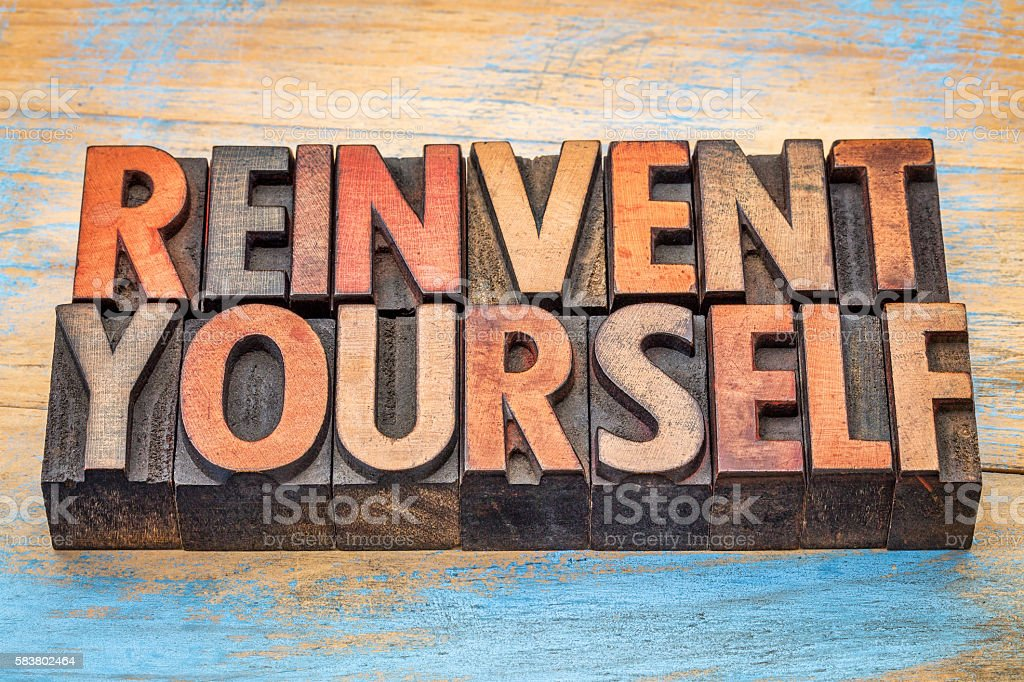 reinvent yourself - motivational words stock photo