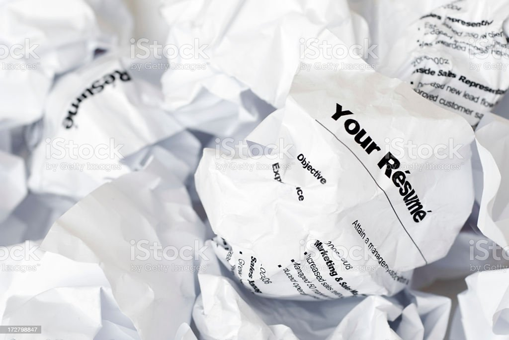 Rejected Job Resume Crumpled Up and Thrown Away in Garbage stock photo