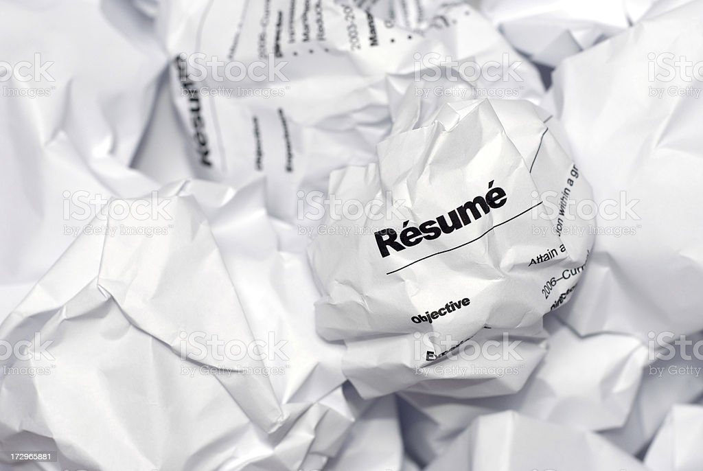 Rejected Job Resume Crumpled Up and Thrown in the Garbage stock photo