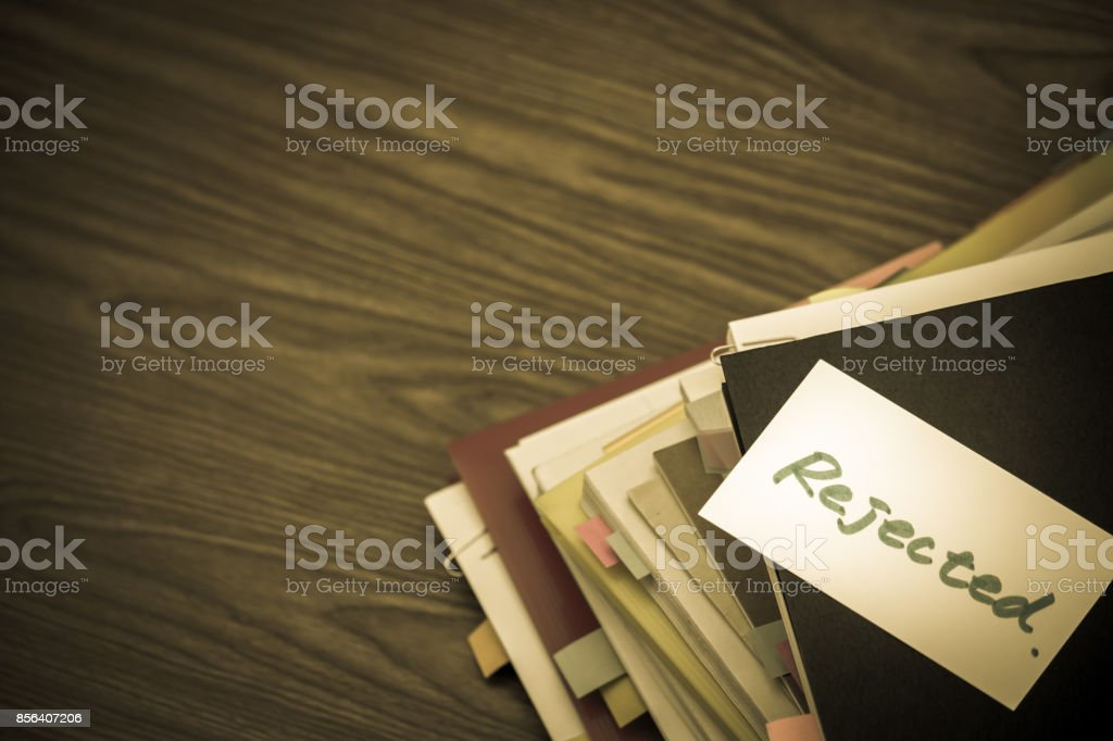 Rejected; The Pile of Business Documents on the Desk stock photo