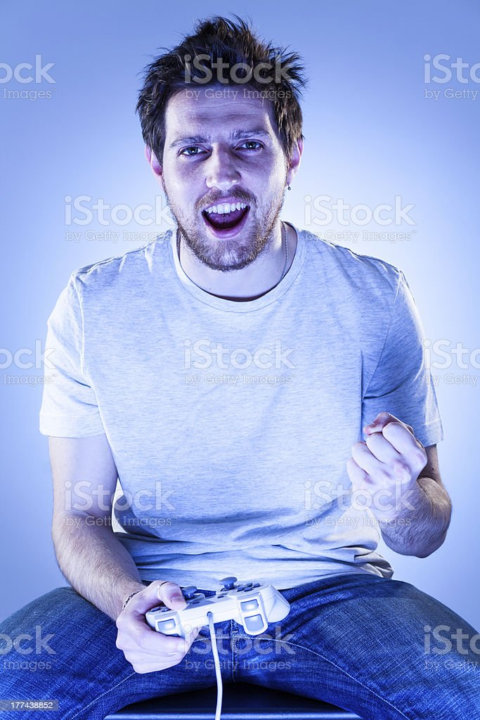 Rejoicing Man with Gamepad royalty-free stock photo