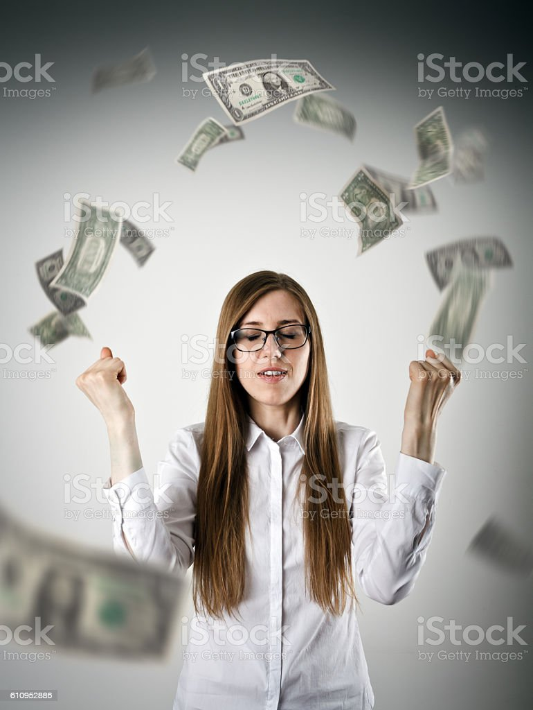 Rejoicing. Woman in white and dollars. stock photo