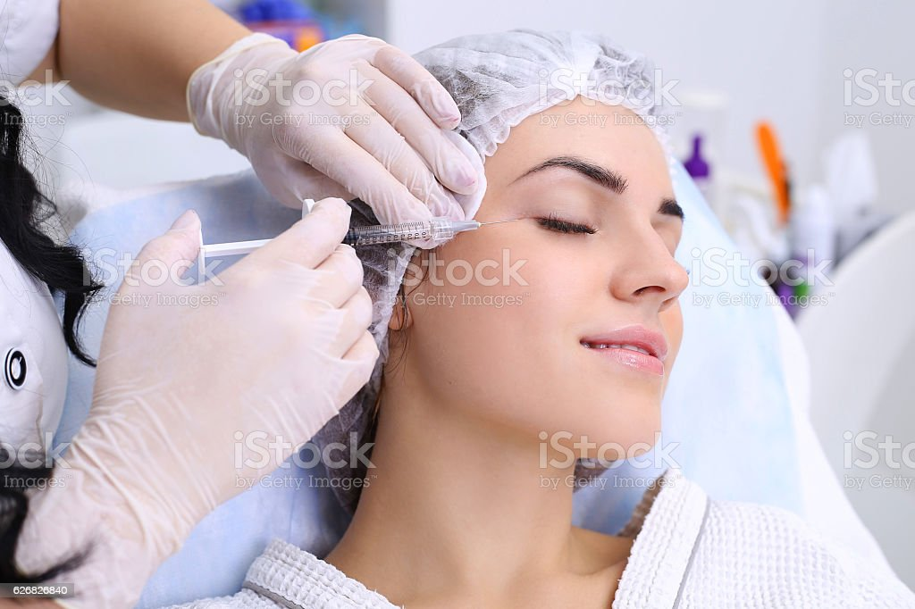 Rejuvenating facial injections. stock photo
