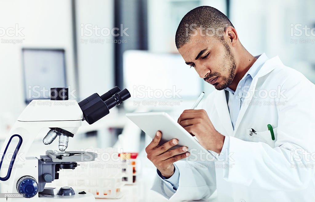Relating his findings to common diseases or conditions stock photo