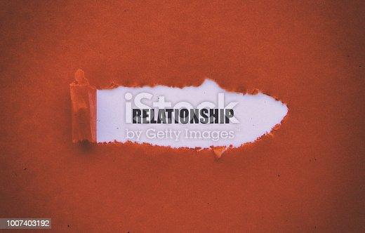 Relationship written under torn paper.