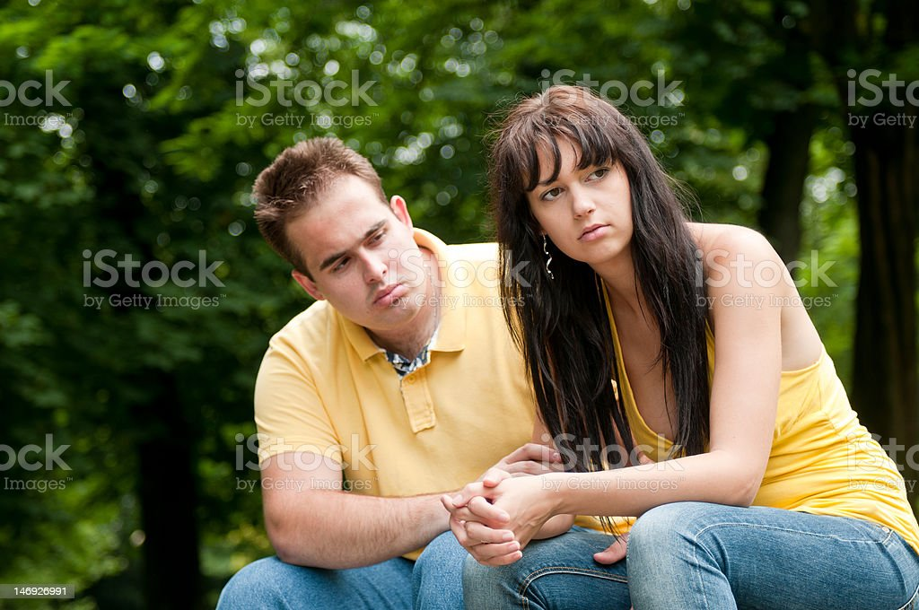Relationship problems - couple in park stock photo