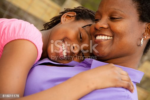 1091098026istockphoto Relationships: African descent mother and daughter hug outside. 515011175