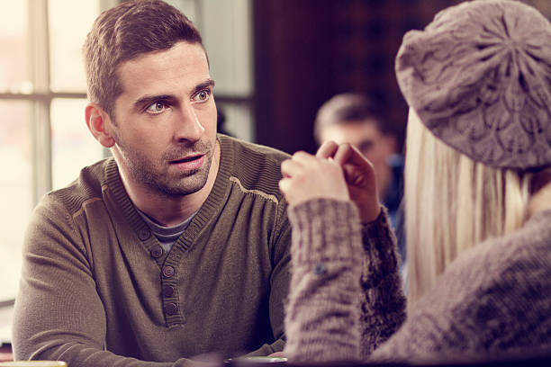Relationships difficulties Young couple in cafe bad date stock pictures, royalty-free photos & images