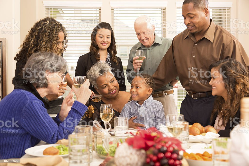 Relationships: Family, friends gather for Christmas dinner or holiday party royalty-free stock photo