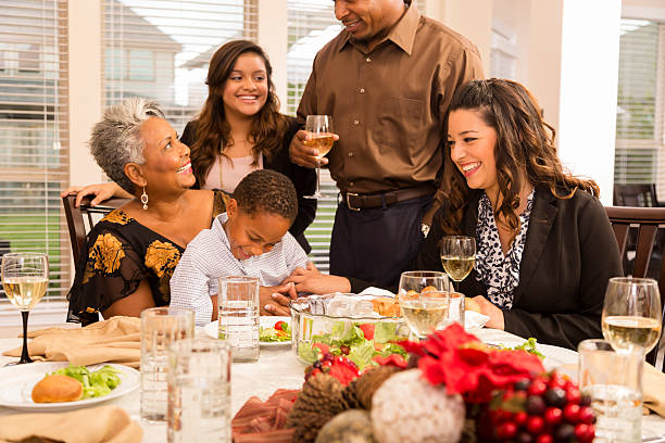 Relationships Family Gathers For Christmas Dinner Or Holiday Party Stock Photo
