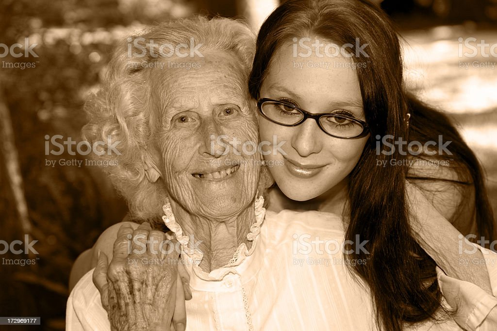 Relationships, generations. Grandmother, granddaughter sepia. Headshot. royalty-free stock photo