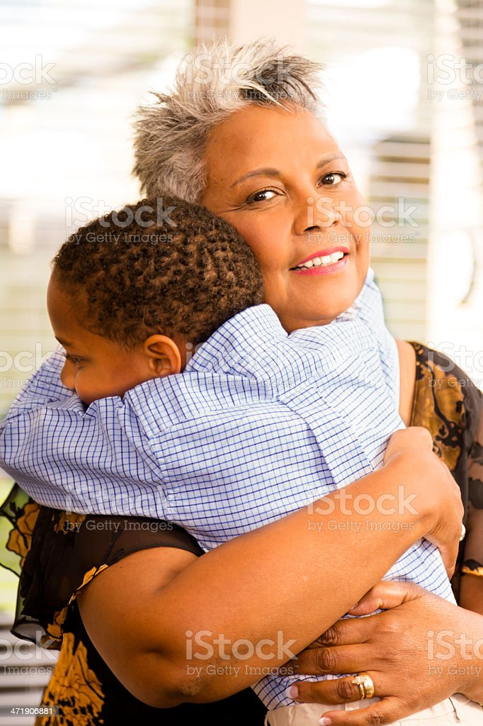 Relationships:  Grandmother lovingly hugs her grandson. royalty-free stock photo