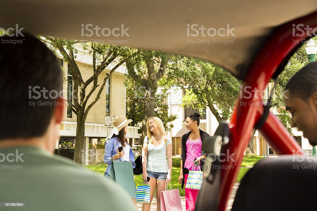 Relationships:  Males spy on female shoppers in downtown USA royalty-free stock photo
