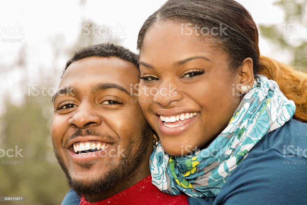 Relationships: Young African descent couple playful outside. Happy, laughing. stock photo