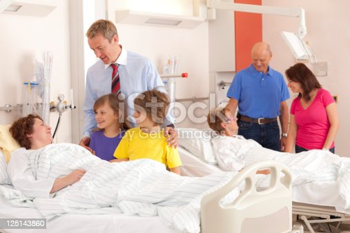 kids with father visiting mother in hospital on women