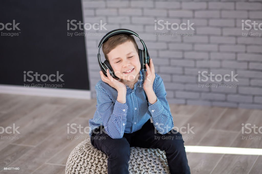 Relax and listening music concept. European boy fill the bit. Boy in casual wear. stock photo