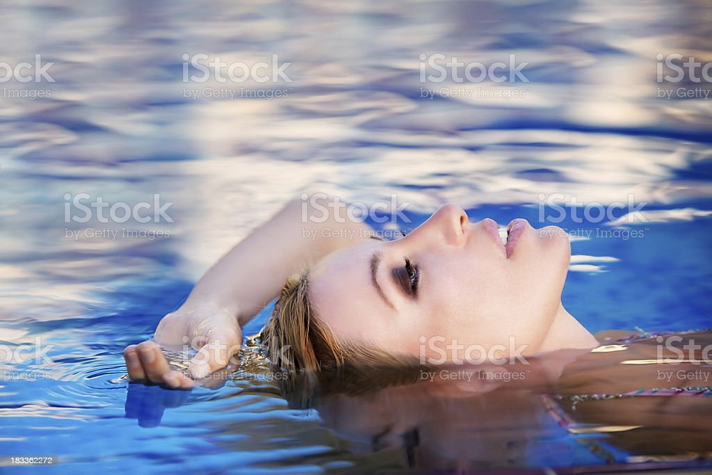 Relax in swimming pool royalty-free stock photo